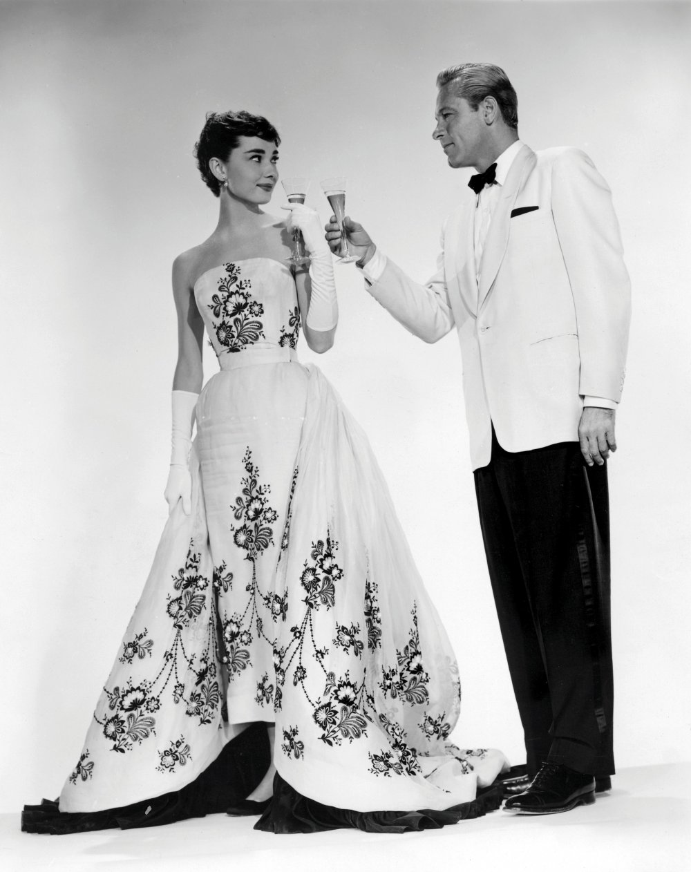 sabrina-1954-001-hepburn-and-holden-raising-toast-00m-wod